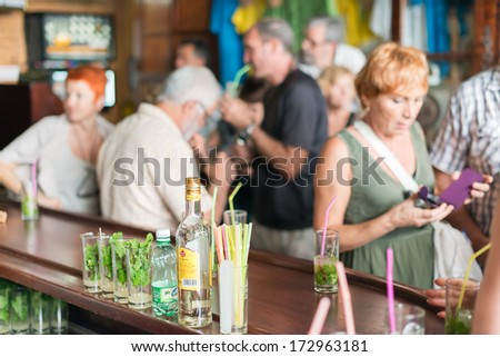 HAVANA, CUBA - JANUARY 20,2014:Tourists drinking mojitos at La Bodeguita del Medio.This restaurant,the birthplace of mojito,was an attraction for the almost 3 million tourists who visited Cuba in 2013