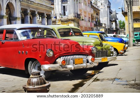 HAVANA, CUBA - JULY 14, 2009: Group of classic vintage american cars parked, commonly used as private taxis in Havana, Cuba. - stock photo
