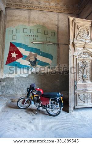 HAVANA, CUBA - JULY 16, 2013: Painting of Fidel Castro on a grunge old wall in Old Havana, Cuba. - stock photo