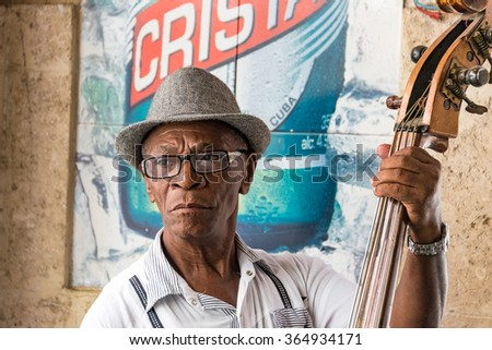HAVANA,CUBA-JULY 4,2015: Traditional Cuban musicians playing son in a bar. Self employed musician entertain tourism in Old Havana and make good money after the economic changes of Raul Castro  - stock photo