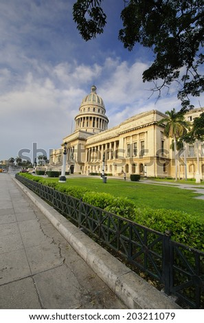 HAVANA, CUBA - JULY 9, 2010. View of El Capitolio, or National Capitol Building, the seat of cuban government until 1959, now the home to the Cuban Academy of Sciences.  - stock photo