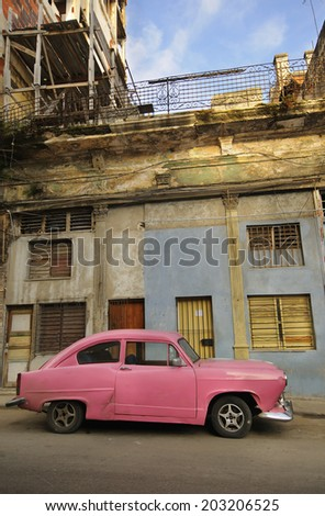 HAVANA, CUBA - JULY 9, 2010. Vintage American car commonly used as private taxi parked in Havana street.  - stock photo