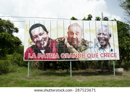 "HAVANA, CUBA - June 10, 2015: Billboard depicting Fidel Castro, Hugo Chavez & Nelson Mandela. The sentence says ""the native land that grows"". - stock photo"