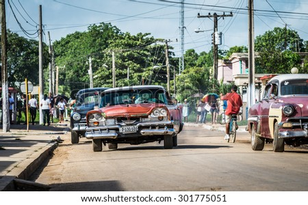 HAVANA, CUBA - JUNE 17, 2015: Street view from American vintage cars drive on the street