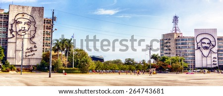 HAVANA, CUBA - MARCH 20, 2015 - Buildings in Havana's Plaza de la Revolucion with portraits of Che Guevara and Fidel Castro. - stock photo
