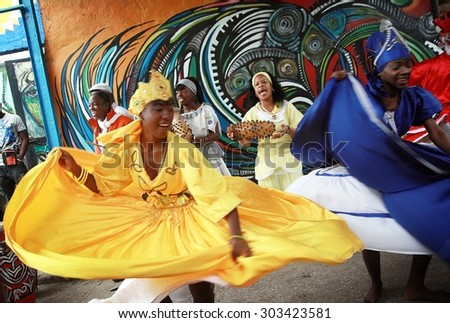 Havana - Cuba, March 14, 2013. Project Callejon de Hamel, dancers in traditional costumes show every weekend their african and cuban art and tradition to visitors and tourists. - stock photo