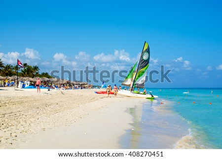 HAVANA,CUBA- MARCH 17,2016 : Tourists at the beautiful beach of Varadero in Cuba - stock photo