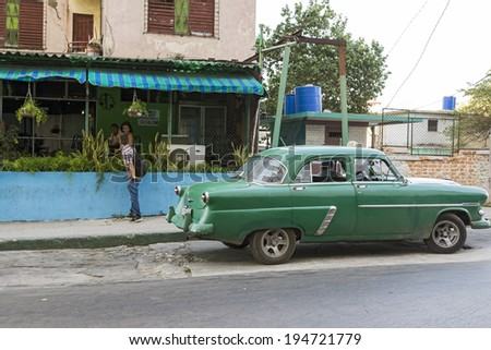 HAVANA , CUBA -  MAY 5, 2014 : Classic old American car. Classic cars are still in use in Cuba and old timers have become an iconic view and a worldwide known attraction. - stock photo