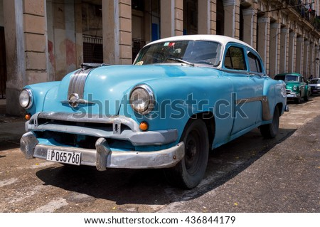 Havana, Cuba - May 28, 2014: Close view of a blue classic american car in the streets of Old Havana