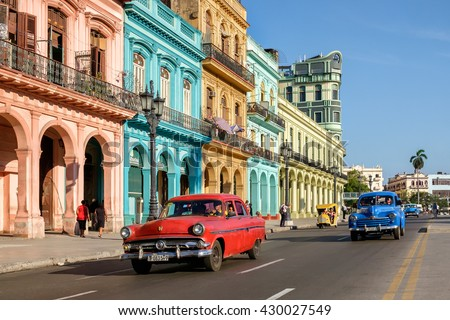HAVANA,CUBA - MAY 26,2016 : Street scene with colorful buildings and old american car in downtown Havana - stock photo