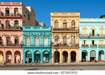 HAVANA,CUBA - MAY 26,2016 : Street scene with old cars and colorful buildings in downtown Havana - stock photo