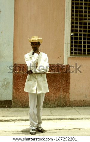 HAVANA, CUBA, MAY 15: Unidentified Man posing with his wood stick and dressed in a traditional cuban costime at  La Havana, 2004.