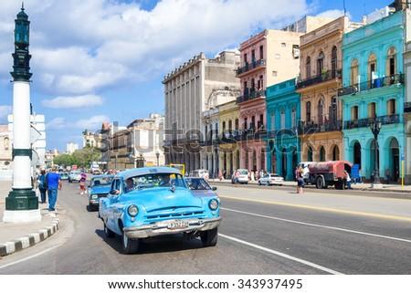 HAVANA,CUBA - NOVEMBER 12, 2015 : Street scene with old american car at an important street in Havana - stock photo