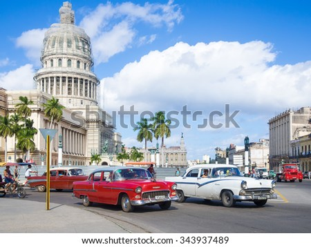 HAVANA,CUBA - NOVEMBER 12, 2015 : Street scene with old american cars near the Capitol of Havana - stock photo