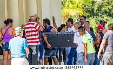 HAVANA, CUBA - OCTOBER 29-Family members carry a casket into funeral on Oct 29, 2015 in Havana, Cuba_ - stock photo