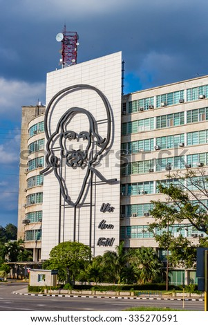 HAVANA, CUBA - OCTOBER 2015:  Large portrait of revolutionary Camilo Cienfuegos is installed on the Ministry of Informatics and Communications government building in the Plaza de la Revolucion - stock photo