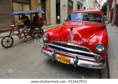 Havana, CUBA - 28 OCTOBER 2012:Old classic American car park on street of Havana,CUBA. Old American cars are iconic sight of Cuba street. - stock photo