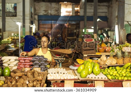 HAVANA,CUBA-OCTOBER 13:Woman selling fruits in market in Havana October 13,2015 in Havana. With 2.4 mil. inhabitants in the city and 3.7 in its urban area, Havana is the largest city in the Caribbean - stock photo