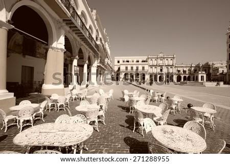 Havana, Cuba - outdoor cafe at famous Plaza Vieja square. Sepia tone - retro monochrome color style. - stock photo