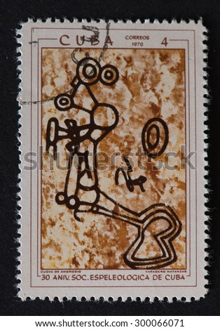 HAVANA,CUBA- REVOLUTIONARY PERIOD: Cuban postal stamp of 1970 showing  Petroglyphs in Cuban Cave and commemorating the 30th Anniversary of the Speleological Society of Cuba.  - stock photo