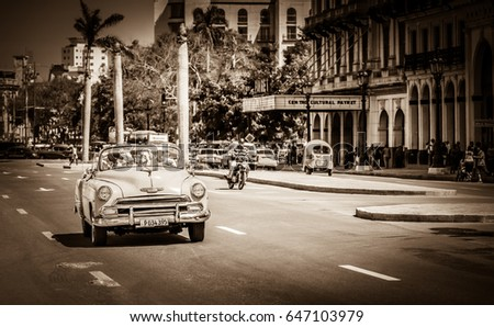 Havana, Cuba - September 14, 2016: HDR - American Cabriolet vintage car drives with tourists on the main street in Havana Cuba - Retro Serie SEPIA Cuba Reportage