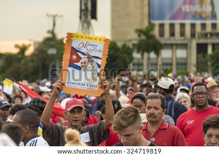 HAVANA,CUBA-SEPTEMBER 20,2015:Scenes of Pope Francis to Havana, specifically the historic Catholic Mass held in the Revolution Square. General public attending the religious mass.