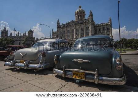 HAVANA/CUBA 4TH JULY 2006 - Old cars in front of the Museum of the Revolution - stock photo