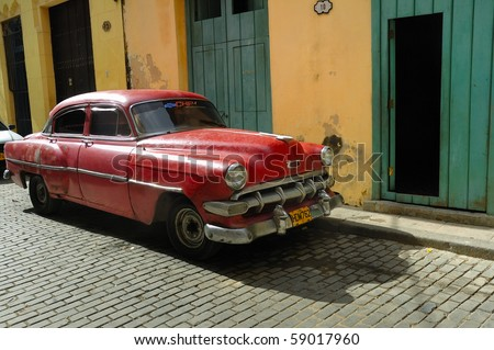 HAVANA - DEC 3: Old classic American car parked in a street of Havana. Most of them are now used as private taxi, December 3, 2008 in Havana, Cuba. - stock photo