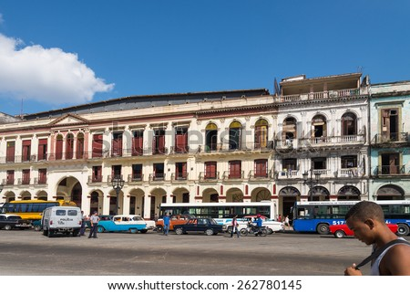 HAVANA - FEB 13: Busy street scene with old buildings and cars on Paseo Del Prado in Old Town of Havana on February 13, 2015. - stock photo