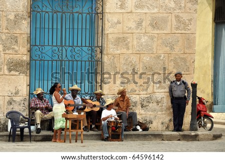 HAVANA - FEB 2:  Street musicians play music for tourists in Havana, Cuba Feb 2, 2010.  Tourism is now Cuba's main source of income and many Cubans depend on tips from tourists to boost their income. - stock photo