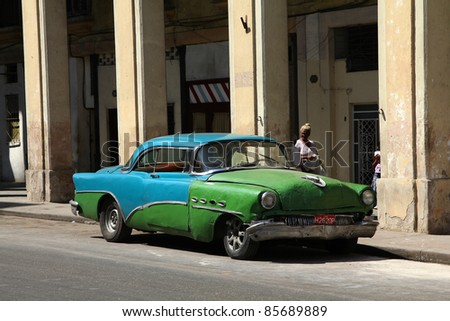 HAVANA - FEBRUARY 27: Classic American car in the street on February 27, 2011 in Havana, Cuba. The multitude of oldtimer cars in Cuba is its major tourism attraction. - stock photo
