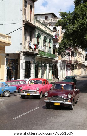 HAVANA - FEBRUARY 27: Classic American cars in the street on February 27, 2011 in Havana, Cuba. The multitude of oldtimer cars in Cuba is its major tourism attraction. - stock photo