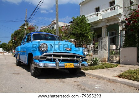 HAVANA - FEBRUARY 24: Classic American Chevrolet car in the street on February 24, 2011 in Havana, Cuba. The multitude of oldtimer cars in Cuba is its major tourism attraction. - stock photo