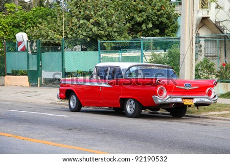 HAVANA - FEBRUARY 24: Classic American Ford car on February 24, 2011 in Havana. Recent law change allows Cubans to trade cars again. Old law resulted in very old fleet of private owned cars in Cuba - stock photo