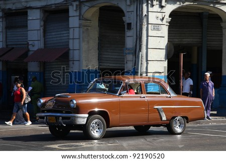 HAVANA - FEBRUARY 24: Classic American Mercury car on February 24, 2011 in Havana. Recent law change allows Cubans to trade cars again. Old law resulted in very old fleet of private owned cars in Cuba - stock photo