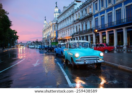 HAVANA - FEBRUARY 18: Classic car and antique buildings on February 18, 2015 in Havana. These vintage cars are an iconic sight of the island - stock photo