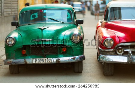 HAVANA - FEBRUARY 25: Classic car and antique buildings on February 25, 2015 in Havana. These vintage cars are an iconic sight of the island - stock photo