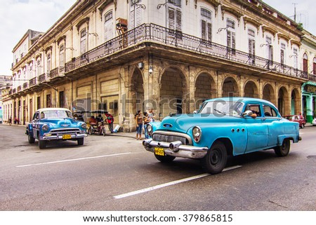 HAVANA - FEBRUARY 12: Classic car on the street on February 12, 2013 in Havana. These old and classic cars are an iconic sight of the Cuba Island. - stock photo