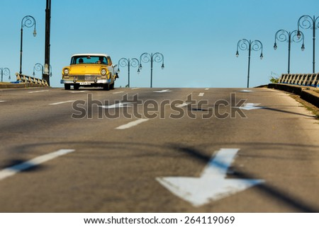 HAVANA - FEBRUARY 26: Classic old car in the street on February 26, 2015 in Havana. These vintage cars are an iconic sight of the island - stock photo