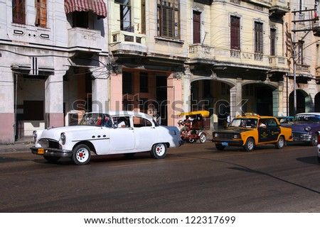HAVANA - FEBRUARY 24: Cubans drive Classic American cars on February 24, 2011 in Havana. Recent change in law allows the Cubans to trade cars after it was forbidden for many years. - stock photo