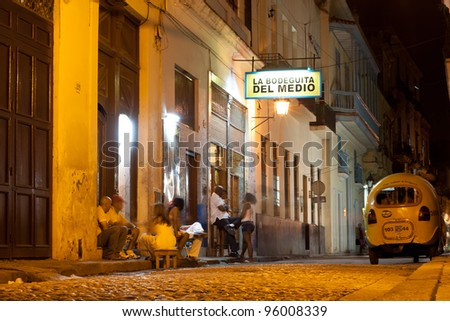 HAVANA-FEBRUARY 21: Customers visit La Bodeguita del Medio February 21, 2012 in Havana, Cuba.Since its opening in 1942, this famous restaurant has been a favorite of Hemingway and Pablo Neruda among other personalities. - stock photo