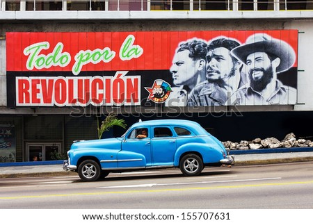HAVANA - FEBRUARY 12: Old classic taxi on the street on February 12, 2013 in Havana. Beside the old classic cars, revolution signes are still visible on the streets of Havana. - stock photo