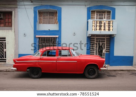 HAVANA - FEBRUARY 27: Oldtimer car parked in the street on February 27, 2011 in Havana, Cuba. The multitude of oldtimer cars in Cuba is its major tourism attraction. - stock photo