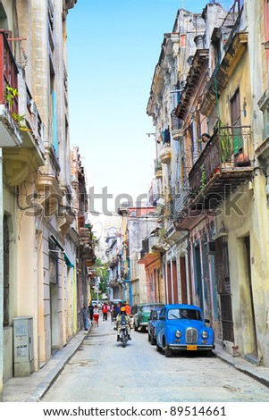 HAVANA-FEBRUARY 3: Street in old Havana. These old cars made before 1959 were the only ones that could be privately bought and sold until a new law was introduced on February 3, 2010 in Havana, Cuba - stock photo