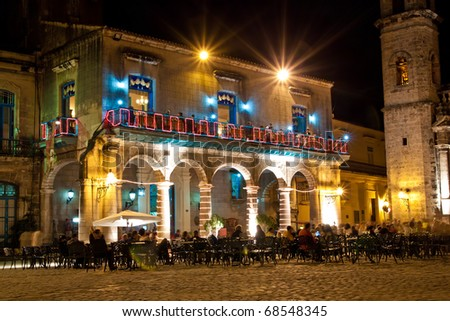 HAVANA-JANUARY 4: A restaurant in the Cathedral Square January 4, 2011 in Havana.Cuba has developed  a state owned infrastructure dedicated to attract tourists  who are a much needed income source - stock photo