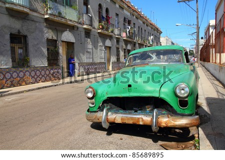 HAVANA - JANUARY 30: Classic American car in the street on January 30, 2011 in Havana, Cuba. The multitude of oldtimer cars in Cuba is its major tourism attraction. - stock photo