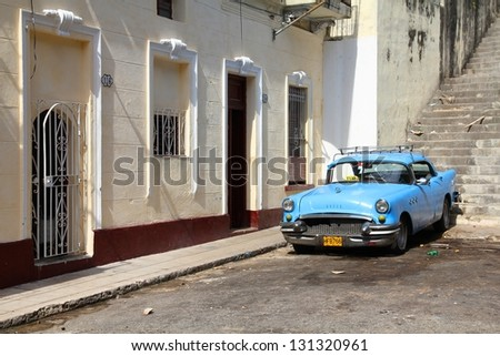 HAVANA - JANUARY 30: Classic American car on January 30, 2011 in Havana. Recent change in law allows the Cubans to trade cars again. Most cars in Cuba are very old because of the old law. - stock photo