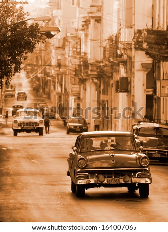 HAVANA - JANUARY 15: Classic cars riding in a street on January 15, 2013 in Havana. These old and classic cars are an iconic sight of the island - stock photo