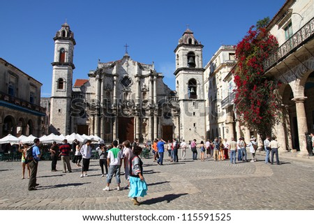 HAVANA - JANUARY 30: Tourists visit the Cathedral on January 30, 2011 in Havana. Havana's Old Town is a UNESCO World Heritage Site and is Cuba's most visited area. - stock photo