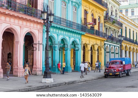 HAVANA-JUNE 21:Typical street scene with people and colorful buildings on June 21, 2013 in Havana.With over 2 million inhabitants Havana is the capital of Cuba and the largest city in the Caribbean - stock photo